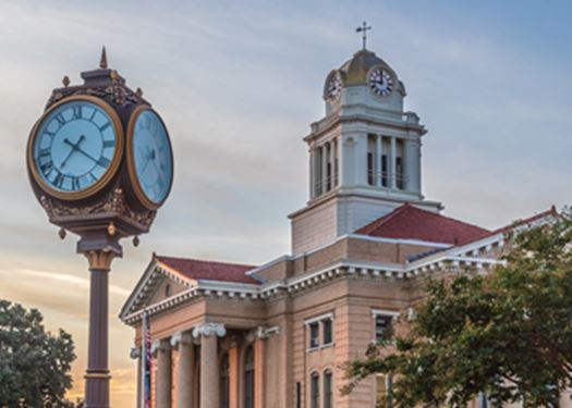 Thomaston City hall with a clock in the foreground